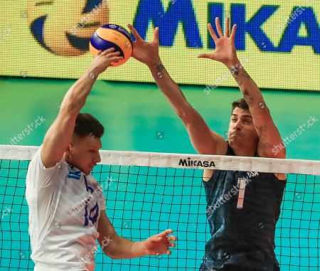 USA's Matthew Anderson (R) in action against Russia's Yaroslav Podlesnykh (L) during the FIVB Volleyball Men's Nations League match between Russia and the USA at Credit Union 1 Arena in Chicago, Illinois, USA, 12 July 2019.