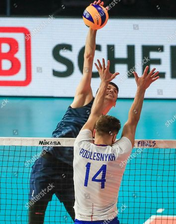 USA's Matthew Anderson (L) in action against Russia's Yaroslav Podlesnykh (R) during the FIVB Volleyball Men's Nations League match between Russia and the USA at Credit Union 1 Arena in Chicago, Illinois, USA, 12 July 2019.