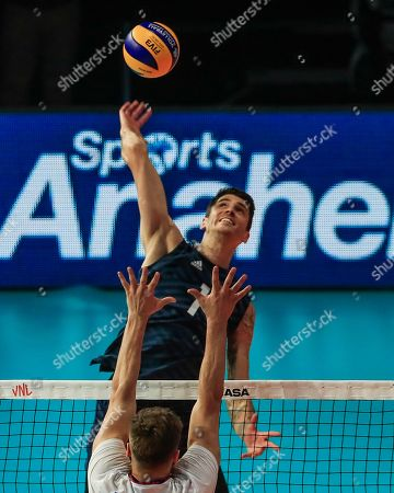 USA's Matthew Anderson (back) in action against Russia's Yaroslav Podlesnykh (front) during the FIVB Volleyball Men's Nations League match between Russia and the USA at Credit Union 1 Arena in Chicago, Illinois, USA, 12 July 2019.