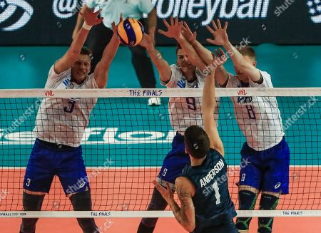 Russia's Dmitry Kovalev (L) Russia's Ivan Iakovlev (C, back) and Russia's Anton Semyshev (R) in action against USA's Matthew Anderson (C, front) during the FIVB Volleyball Men's Nations League match between Russia and the USA at Credit Union 1 Arena in Chicago, Illinois, USA, 12 July 2019.