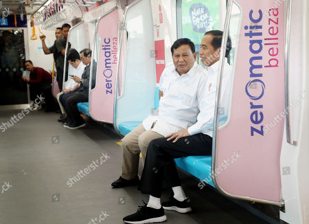 Indonesian President Joko Widodo (R) talks to Indonesian presidential candidate Prabowo Subianto (L) during their meeting on a train in Jakarta, Indonesia, 13 July 2019. Jokowi and Prabowo meet after Indonesia's Constitutional judge rejected the claims of candidate Prabowo's legal team in court to challenge the results of the presidential election.