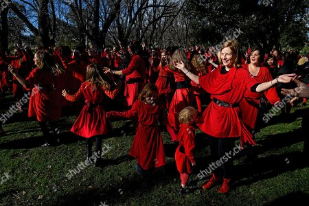 Kate Bush fans dressed in red dance as they recreate her film clip from the song 'Wuthering Heights' during The Most Wuthering Heights Day Ever flash mob at Edinburgh Gardens in Melbourne, Australia, 13 July 2019. Annually a group of Kate Bush fans re-enact the choerography of the singer's famous song 'Wuthering Heigths'.