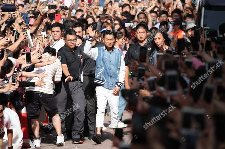 Andy Lau (C) greets fans as he attends a promotional event for 'The White Storm 2: Drug Lords' in Taipei, Taiwan, 13 July 2019. The movie opened in Taiwanese theaters on 12 July.