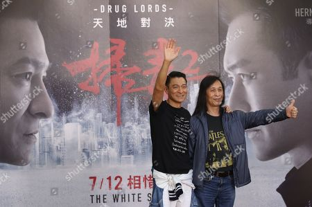 Andy Lau (L) and Hong Kong film director Herman Yau (R) attend a promotional event for 'The White Storm 2: Drug Lords' in Taipei, Taiwan, 13 July 2019. The movie opened in Taiwanese theaters on 12 July.