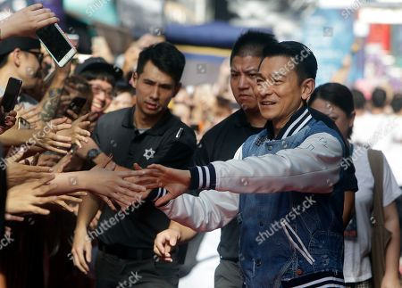 "Hong Kong actor Andy Lau is cheered by fans during a media event to promote his new movie ""The White Storm 2 - Drug Lords"" in Taipei, Taiwan"