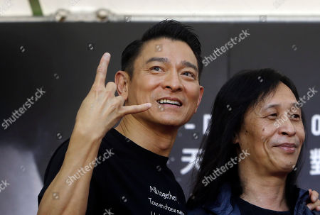 "Andy Lau, Herman Yau. Hong Kong actor Andy Lau with director Herman Yau gestures to fans during a media event to promote their new movie ""The White Storm 2 - Drug Lords"" in Taipei, Taiwan"