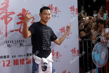 "Hong Kong actor Andy Lau poses for a photo during a media event to promote his new movie ""The White Storm 2 - Drug Lords"" in Taipei, Taiwan"