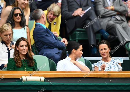 Catherine Duchess of Cambridge looks on as Meghan Duchess of Sussex and Pippa Middleton chat in the Royal Box on Centre Court