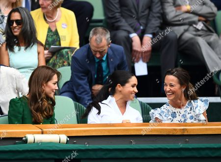 Catherine Duchess of Cambridge looks on as Meghan Duchess of Sussex and Pippa Middleton laugh in the Royal Box on Centre Court