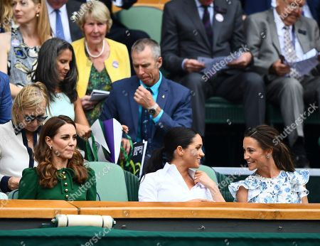 Stock Image of Catherine Duchess of Cambridge looks on as Meghan Duchess of Sussex and Pippa Middleton chat in the Royal Box on Centre Court