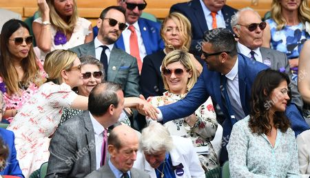 Lily James shakes hands with Christian Contreras, with his wife Jodie Whittaker and James' grandmother Marinette Mantle look on
