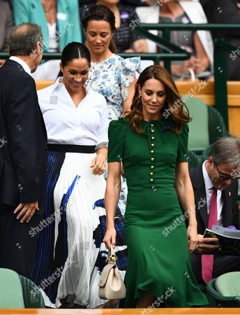 Catherine Duchess of Cambridge, Meghan Duchess of Sussex and Pippa Middleton arrive in the Royal Box on Centre Court