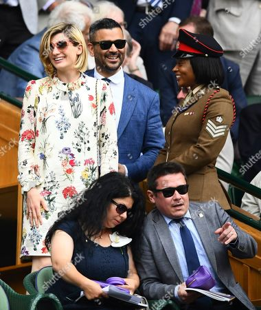 Stock Image of Jodie Whittaker and her husband Christian Contreras arrive in the Royal Box on Centre Court