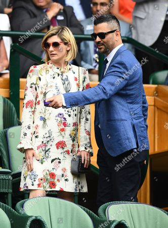 Stock Photo of Jodie Whittaker and her husband Christian Contreras arrive in the Royal Box on Centre Court