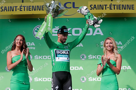 Stock Image of Slovakia's Peter Sagan of Bora Hansgrohe team celebrates on the podium retaining the best sprinter's green jersey following the 8th stage of the 106th edition of the Tour de France cycling race over 200km between Macon and Saint-Etienne, France, 13 July 2019.