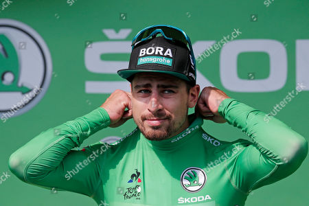 Slovakia's Peter Sagan of Bora Hansgrohe team celebrates on the podium retaining the best sprinter's green jersey following the 8th stage of the 106th edition of the Tour de France cycling race over 200km between Macon and Saint-Etienne, France, 13 July 2019.