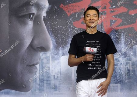 "Hong Kong actor Andy Lau smiles to fans during a media event to promote his new movie ""The White Storm 2 - Drug Lords"" in Taipei, Taiwan"
