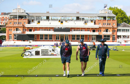 Trevor Bayliss (England Head Coach - R) Paul Collingwood & Jos Buttler (WK) of England (L) walk to Nets with the Lord's pavilion behind