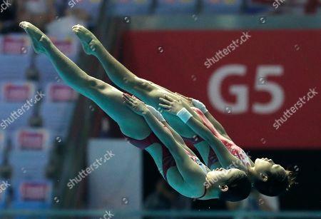China's Lu Wei and Zhang Jiaqi compete in the 10m platform women's synchro diving final at the World Swimming Championships in Gwangju, South Korea