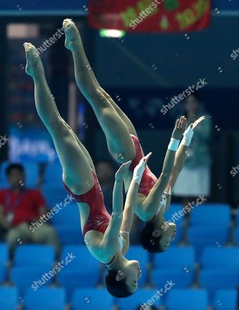 Stock Picture of China's Lu Wei and Zhang Jiaqi compete in the 10m platform women's synchro diving final at the World Swimming Championships in Gwangju, South Korea
