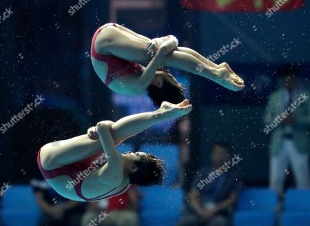 Stock Photo of China's Lu Wei and Zhang Jiaqi compete in the 10m platform women's synchro diving final at the World Swimming Championships in Gwangju, South Korea