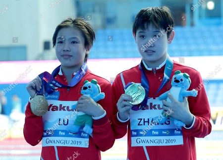 Gold medalists China's Lu Wei, left, and Zhang Jiaqi pose with their medals after winning the 10m platform women's synchro diving final at the World Swimming Championships in Gwangju, South Korea