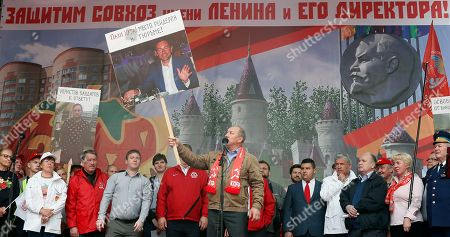Communist Party of the Russian Federation leaders stay on the stage with a banner reading 'Defend the Sovkhoz Imeni Lenina and its director' during a rally 'For justice and the rights of citizens! Stop the arbitrariness of power! Defending Grudinina!' on the Revolution Square in Moscow, Russia, 13 July 2019. The participants demand to stop the arbitrariness in relation to the Sovkhoz Imeni Lenina Director, former Russian presidential candidate of the Communist Party, Pavel Grudinin . According to the protesters, the authorities are planning a 'raider seizure' of this PeopleÕs Enterprise.
