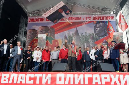 Communist Party of the Russian Federation leaders stay on the stage throwing a banner reading 'Defend the Sovkhoz Imeni Lenina and its director' during a rally 'For justice and the rights of citizens! Stop the arbitrariness of power! Defending Grudinina!' on the Revolution Square in Moscow, Russia, 13 July 2019. The participants demand to stop the arbitrariness in relation to the Sovkhoz Imeni Lenina Director, former Russian presidential candidate of the Communist Party, Pavel Grudinin . According to the protesters, the authorities are planning a 'raider seizure' of this PeopleÕs Enterprise.