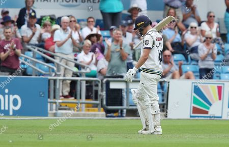 Yorkshire's Gary Ballance  walks off the pitch after scoring 111