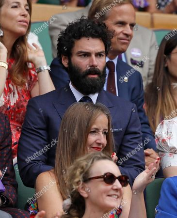 Actor Aidan Turner sits in the Royal Box on Centre Court for the women's singles final match between Serena Williams of the United States and Romania's Simona Halep on day twelve of the Wimbledon Tennis Championships in London