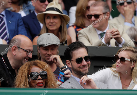 Alexis Ohanian, the husband of Serena Williams of the United States, and her mother Oracene Price, sit in the players box to watch her play Romania's Simona Halep in the women's singles final match on day twelve of the Wimbledon Tennis Championships in London