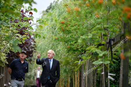 Conservative leadership contender Boris Johnson (R) is guided by business owner Paul King during a campaign event at King and Co. Tree Nursery, in Braintree, Britain 13 July 2019. Johnson is one of two Conservative Party candidates along with Jeremy Hunt who are vying to be Britain's next Prime Minister. The winner will be announced on 23 July.