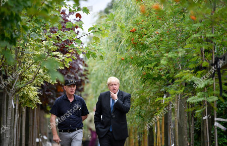 Stock Picture of Conservative leadership contender Boris Johnson (R) is guided by business owner Paul King during a campaign event at King and Co. Tree Nursery, in Braintree, Britain 13 July 2019. Johnson is one of two Conservative Party candidates along with Jeremy Hunt who are vying to be Britain's next Prime Minister. The winner will be announced on 23 July.