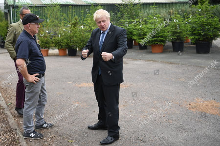 Conservative leadership contender Boris Johnson (R) talks with business owner Paul King during a campaign event at King and Co. Tree Nursery, in Braintree, Britain 13 July 2019. Johnson is one of two Conservative Party candidates along with Jeremy Hunt who are vying to be Britain's next Prime Minister. The winner will be announced on 23 July.