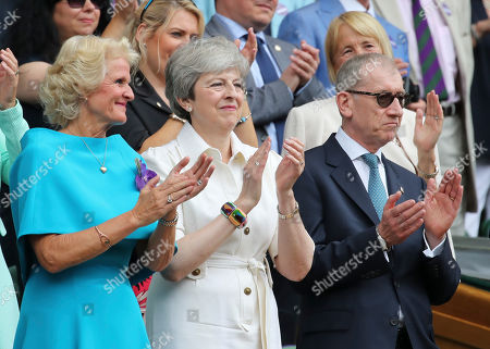 Mrs Gill Brook, Theresa May and Philip May in the Royal Box on Centre Court