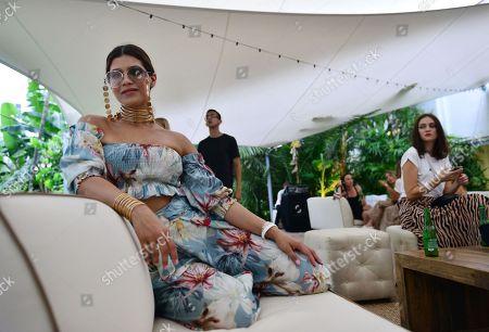 Karla Martinez attends Nu Wave Swim's Parke & Ronen Mens Swimwear presentation at Miami Beach Botanical Gardens.