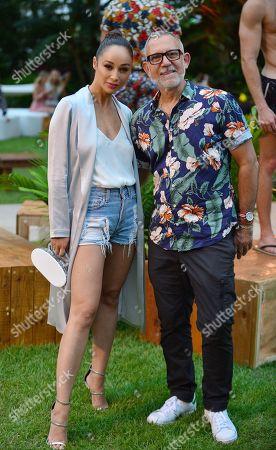 Cara Santana and Designer Ronen Jehezkel attends Nu Wave Swim's Parke & Ronen Mens swimwear show at Miami Beach Botanical Gardens.