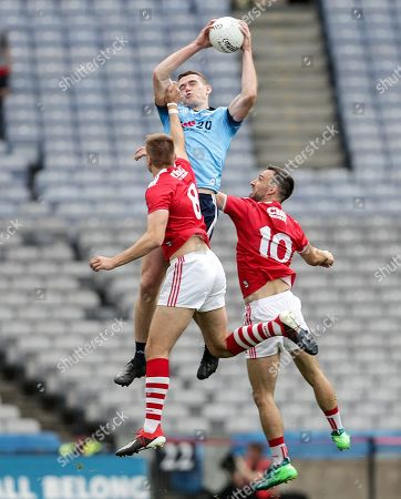Dublin vs Cork. Dublin's Brian Fenton with Ian Maguire and Kevin O'Driscoll of Cork