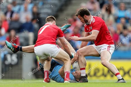 Dublin vs Cork. Dublin's Con O'Callaghan is tackled by Mattie Taylor an James Loughrey of Cork