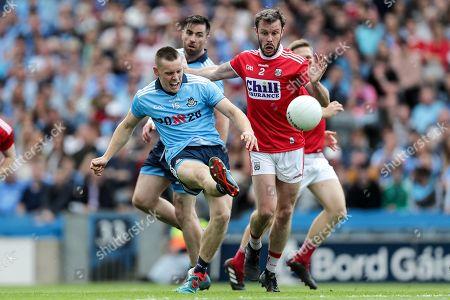 Stock Picture of Dublin vs Cork. Dublin's Con O'Callaghan scores a point despite James Loughrey of Cork