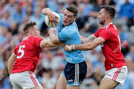 Stock Picture of Dublin vs Cork. Dublin's Brian Fenton with Liam O'Donovan and Kevin O'Driscoll of Cork