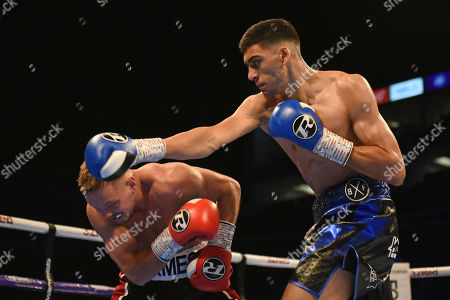 Hamzah Sheeraz (blue shorts) defeats Scott James during a Boxing Show at The O2 on 13th July 2019