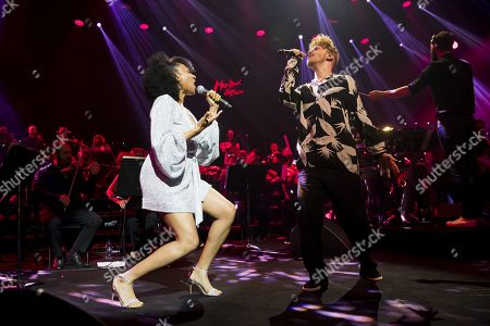 US singer Shelea, left, and British singer-songwriter, Daley, right, react during the Quincy Jones soundtrack of the 80?s celebration evening at the Auditorium Stravinski during the 53rd Montreux Jazz Festival (MJF), in Montreux, Switzerland, 13 July 2019. The MJF runs from June 28 to July 13 and features 450 concerts.