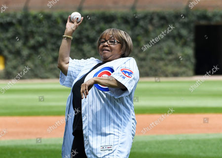 Mavis Staples, rhythm and blues and gospel singer throws out a ceremonial first pitch before the game between the Chicago Cubs and the Pittsburgh Pirates in a baseball game, Saturday, July, 13, 2019, in Chicago