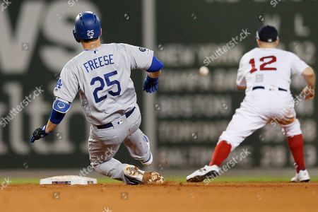 Los Angeles Dodgers' David Freese (25) slides into second base on his two-run double as Boston Red Sox's Brock Holt (12) gets the throw during the fifth inning of a baseball game in Boston