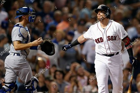 Christian Vazquez, Austin Barnes. Boston Red Sox's Christian Vazquez, right, reacts beside Los Angeles Dodgers' Austin Barnes after striking out swinging during to end the sixth inning of a baseball game in Boston