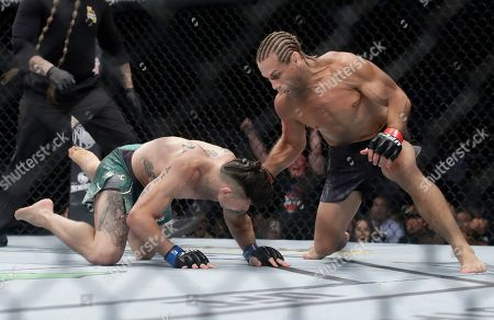 Urijah Faber, Ricky Simon. Urijah Faber, right, punches Ricky Simon during a bantamweight mixed martial arts bout at UFC Fight Night in Sacramento, Calif., . Faber won by first-round knockout