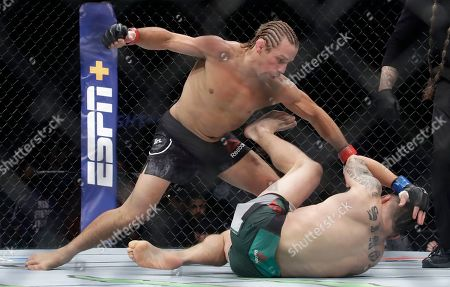 Urijah Faber, Ricky Simon. Urijah Faber, left, punches Ricky Simon during a bantamweight mixed martial arts bout at UFC Fight Night in Sacramento, Calif., . Faber won by first-round knockout