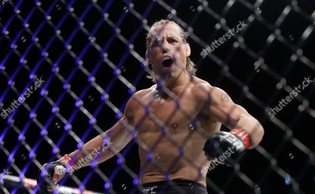 Urijah Faber celebrates after defeating Ricky Simon during a bantamweight mixed martial arts bout at UFC Fight Night in Sacramento, Calif., . Faber won by first-round knockout