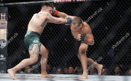 Urijah Faber, Ricky Simon. Urijah Faber, right, connects with a punch to knock down Ricky Simon during a bantamweight mixed martial arts bout at UFC Fight Night in Sacramento, Calif., . Faber won by first-round knockout